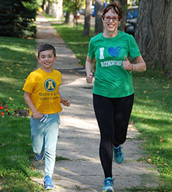 Dr. Kim Kelly, AMA CSH Representative, and her son out for a run.
