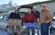 Left to right: Food Food Bank President Terry Grinevitch, Dr. Allan Garbutt, Food Bank Director Bruce Street, and Food Bank Treasurer Tom Head. (Joni MacFarlane photo)