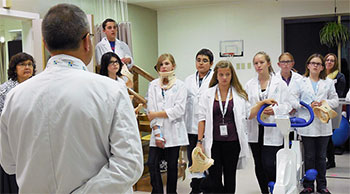 Camrose physician, Dr. Christopher Nichol helps junior high students get a glimpse into the world of medicine.