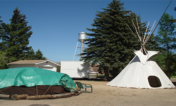 Sweat lodge and teepee in Alberta. Photo by Marty Landrie, Indigenous Health Committee.